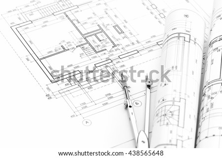 architectural background with plan, blueprints rolls and drawing compass - stock photo