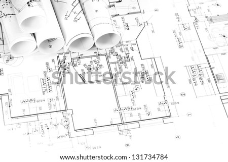 Architectural background with rolls of blueprints - stock photo