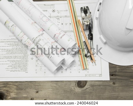 Architectural blueprint of office building with a pencil on wood table - stock photo