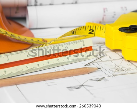 Architectural blueprint of office building with a pencils