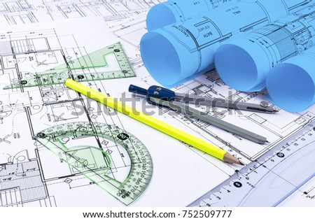 Architecture blueprint stock images royalty free images vectors architectural blueprints and blueprint rolls and a drawing instruments on the worktable drawing compass malvernweather Gallery