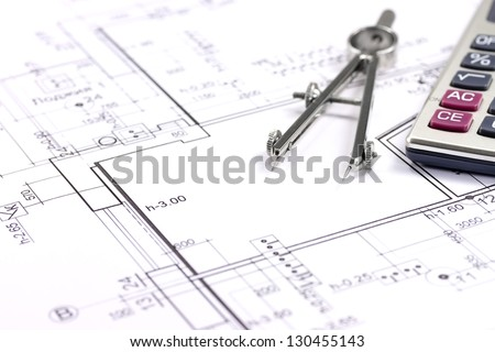 Architectural blueprints, drawing compass and calculator