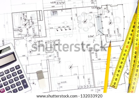 Architectural blueprints, pencil, ruler and calculator - stock photo