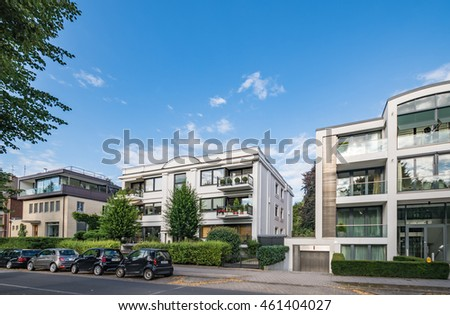 Architectural buildings along the Alster canal in Hamburg Germany  Luxury old mansions Winterhude neighbourhood against blue sky on sunny summer day, image for real estate agent business, realtor blog