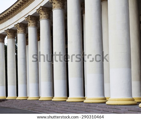 Architectural detail: a row of ancient greek columns - stock photo