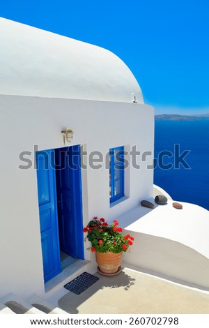 Architectural detail and view into volcanic caldera in Oia village, Santorini, Greece - stock photo