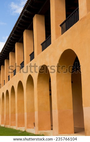 architectural detail of a colonial Spanish building with arches - stock photo