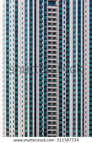 architectural detail of a skyscraper or a highrise condominium - stock photo