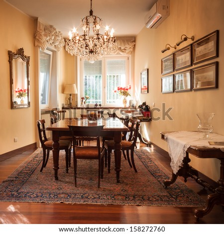 Architectural detail of an elegant dining room with table and chairs - stock photo