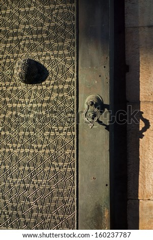 Architectural detail of an old Turkish door. Fatih Mosque in Istanbul, Turkey.