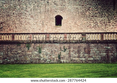 Architectural Detail of Exterior Stone Wall, Railing and Green Grass on Grounds of Heidelberg Castle, Baden-Wurttemberg, Germany - stock photo