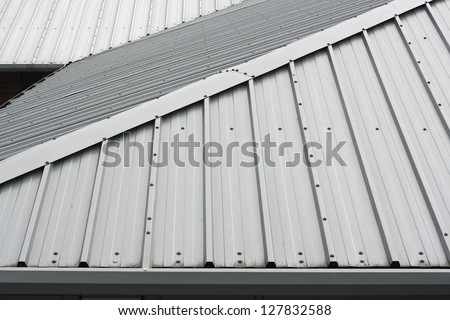 Architectural detail of metal roofing on commercial construction of modern building complex - stock photo