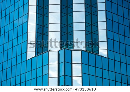 architectural detail of office skyscraper blue glass exterior and reflections
