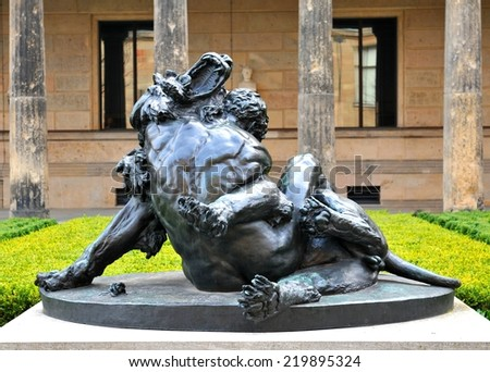 Architectural detail of statue depicting Hercules and the Nemean Lion (Berlin, Germany) - stock photo