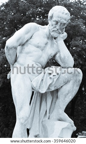Architectural detail of statue depicting nude man in Luxembourg Gardens, Paris, France