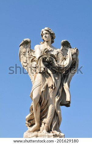 Architectural detail of stone angel against blue sky in Rome, Italy - stock photo