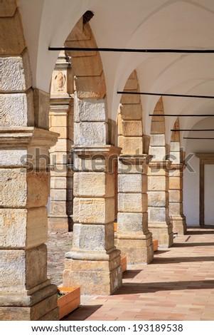 Architectural detail of the arcades in the renaissance castle in Moravska Trebova, Czech Republic. Castle designed by Italian architects, built of sandstone. - stock photo