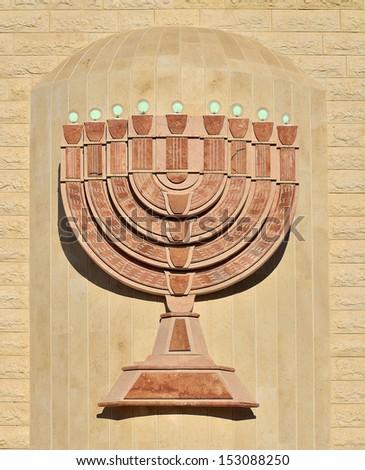 architectural detail of the facade synagogue menorah - stock photo