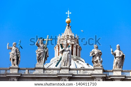 Architectural detail of top of St. Peter's Basilica in Vatican City, Rome, Italy. - stock photo