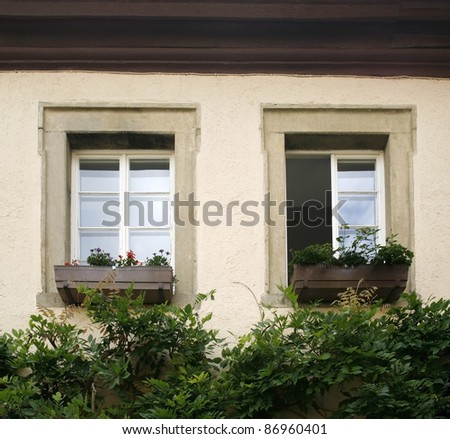 architectural detail of two windows in a small castle in germany