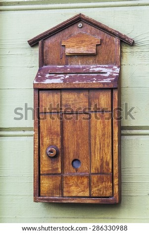architectural detail vintage old wooden mail box on the wall in Istanbul - stock photo