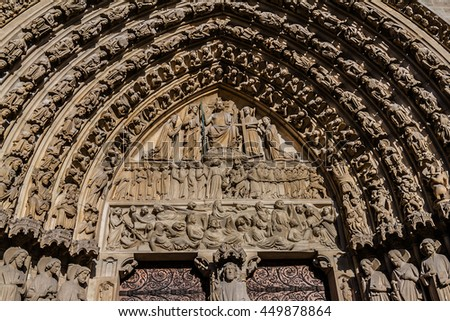 Architectural details entrance of Cathedral Notre Dame de Paris. Cathedral Notre Dame de Paris - most famous Gothic, Roman Catholic cathedral (1163-1345) on eastern half of Cite Island. France, Europe - stock photo