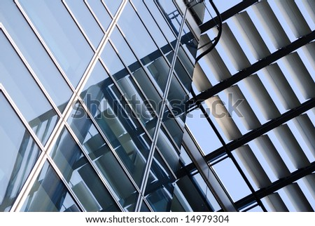 Architectural details of building showing window reflections