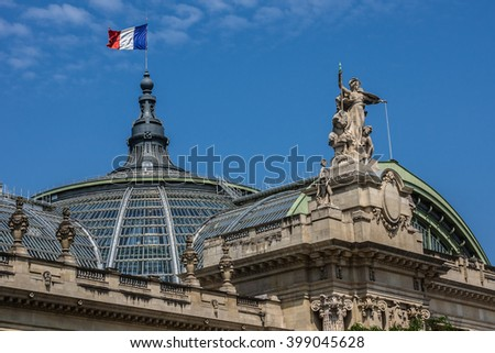 Architectural details of Grand Palais des Champs-Elysees in Paris, France. Grand Palais in Beaux-Arts architecture style was built for Universal Exposition of 1900 and made of glass, iron and steel. - stock photo