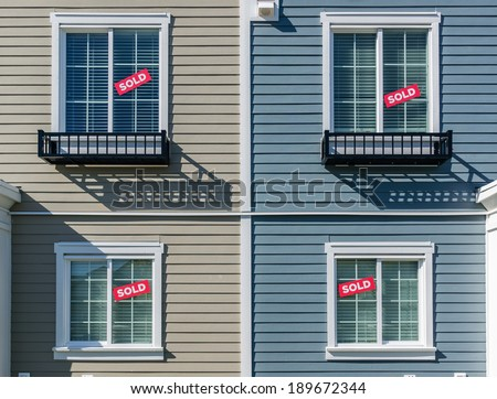 Architectural details of modern apartment building. Sign SOLD in the windows. - stock photo
