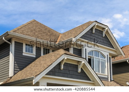 Architectural details of new houses in North America. - stock photo
