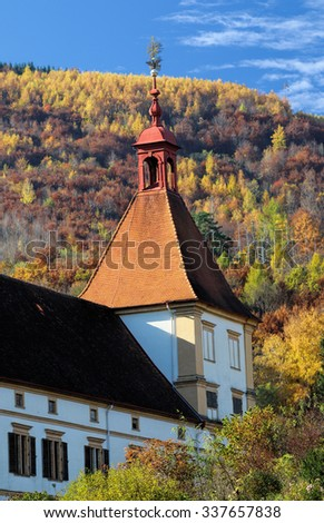 Architectural details of the Eggenberg (Graz, Austria) castleâ??s tower in autumn colors. - stock photo