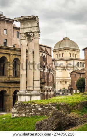 Architectural details of Theatre of Marcellus ruins in Rome city centre, Italy, with dramatic cloudy sky in the background. - stock photo