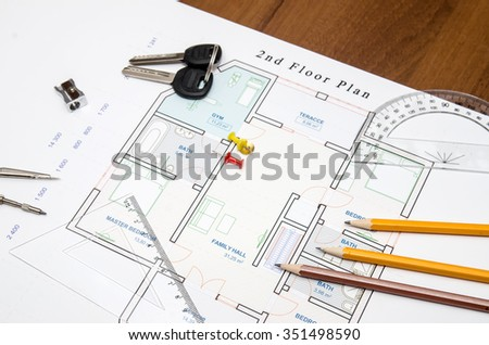 architectural drawings with pencil, ruler, compass and keys