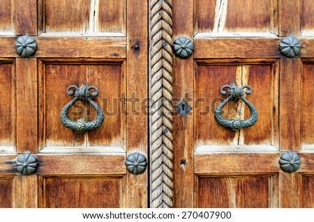 Architectural elements of St. Sophia Cathedral doors in Veliky Novgorod - metal locks on the background of the old wooden texture - stock photo