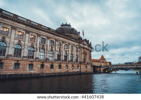 Architectural Exterior View of Historical Bode Art Museum Alongside Spree River with Small Bridges Connecting Museum Island to Mainland on Overcast Day in Berlin, Germany - stock photo