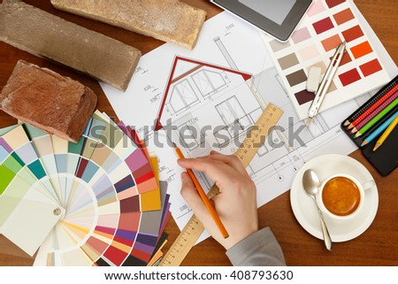 architectural facade drawing, Two color palette guide, pencils and ruler.Graphic designer at work