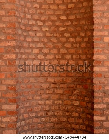 Architectural Feature Of A Curved Red Brick Wall For A Chimney - stock photo
