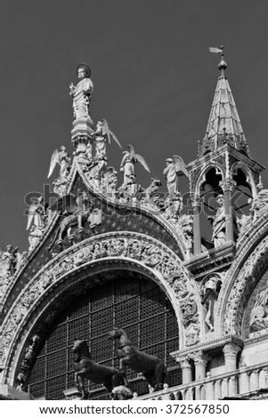 Architectural fragment of Patriarchal Cathedral Basilica of Saint Mark. Piazza San Marco, Venice, Italy. Black and white. - stock photo