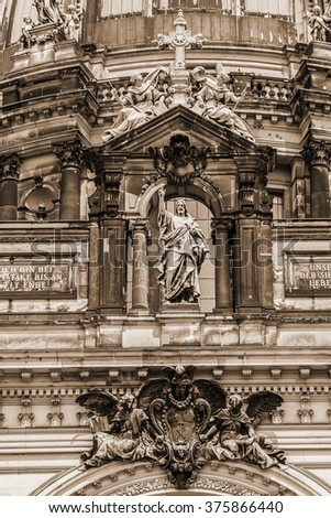 Architectural fragments of Berlin Cathedral (Berliner Dom) - famous landmark on the Museum Island in Mitte district of Berlin. It was built between 1895 and 1905. Germany. Vintage, sepia. - stock photo