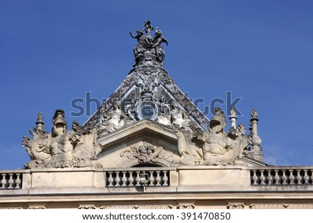 Architectural fragments of famous Versailles Palace located in Paris, France. The Palace of Versailles was a royal chateau. It was added to the UNESCO list of World Heritage Sites. - stock photo