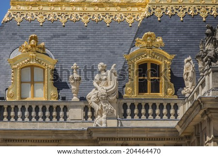 Architectural fragments of famous Versailles palace. The Palace of Versailles was a royal chateau. It was added to the UNESCO list of World Heritage Sites. Paris, France. - stock photo