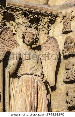 Architectural fragments of Notre-Dame de Reims cathedral facade (Our Lady of Reims, 1275). Reims, Champagne-ardenne, France. It is seat of Archdiocese of Reims, where kings of France were crowned. - stock photo