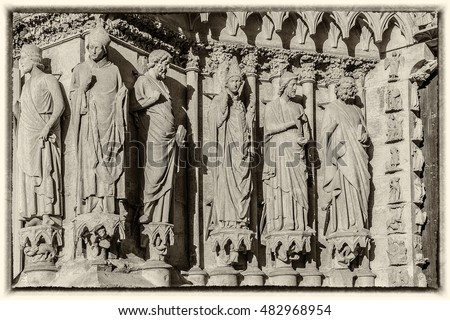 Architectural fragments of Notre-Dame de Reims cathedral facade (Our Lady of Reims, 1275). Reims, Champagne-ardenne, France. Old style vintage photo.