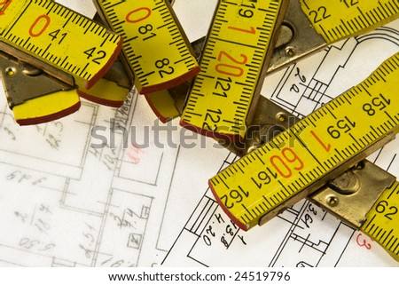 Architectural plan and ruler - stock photo