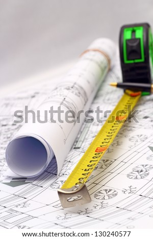 architectural plans and measurement instruments over the office table