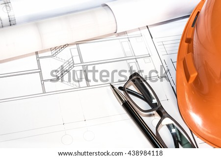 architectural plans project drawing and pen with blueprints rolls, glasses and orange helmet, architect engineering and contractor concept - stock photo