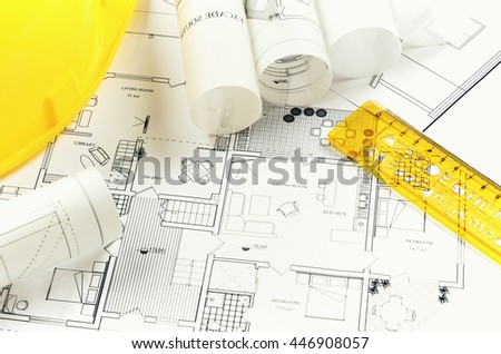 Architectural project and yellow helmet