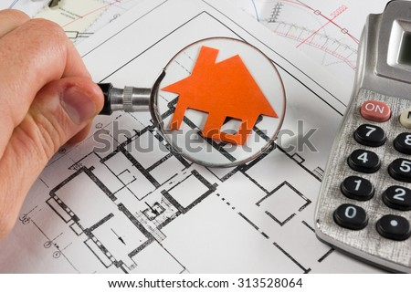 Architectural project, blueprints, magnifying glass, calculator, model house on construction plan for house building. Real Estate Concept. - stock photo