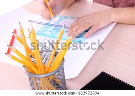 Architectural project with female hands, close up - stock photo