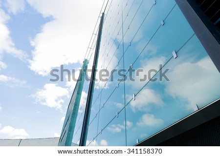 architecture and construction concept - modern office building facade - stock photo